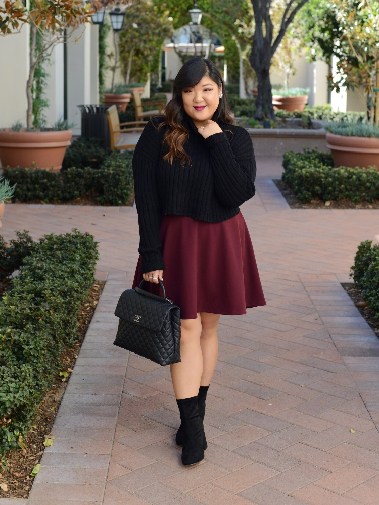 Curvy Girl Chic Plus Size Chunky Cropped Turtleneck Sweater and Burgundy Skirt Chanel Coco Handle Wide Width Sock Boots