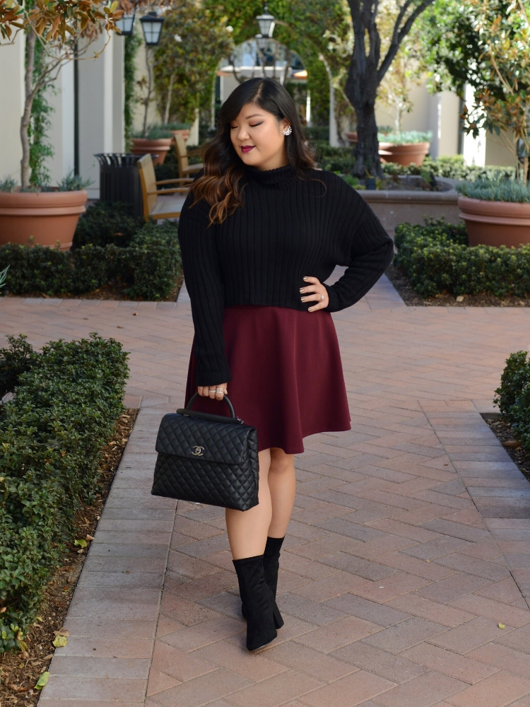 Curvy Girl Chic Plus Size Chunky Cropped Turtleneck Sweater and Burgundy Skirt Chanel Coco Handle Large Wide Width Sock Boots