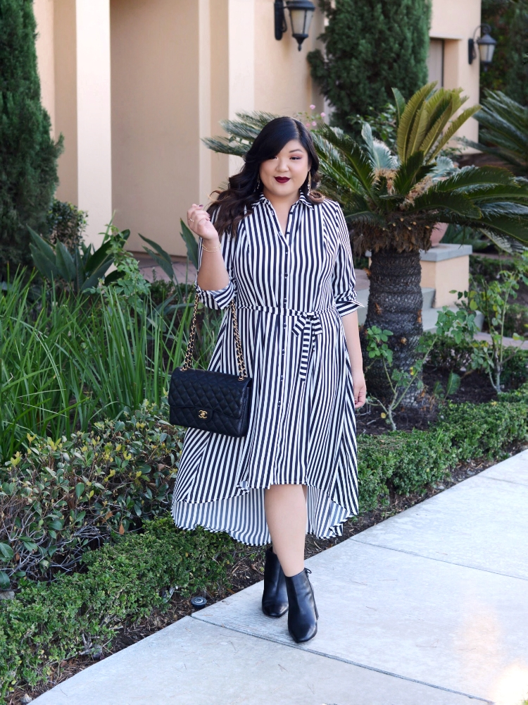 Curvy Girl Chic Girl With Curves Dia & Co Collection Black and White Striped High Low Midi Dress with Ankle Boots and Chanel Black Classic Flap Jumbo